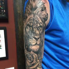 Realistic Lion with Rose in Black and Gray