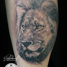 Tatuaje León realista by Richard Tiki